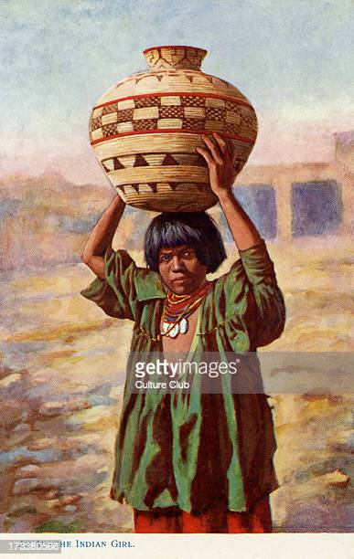 Apache girl carrying a pot and wearing traditional dress early twentieth century