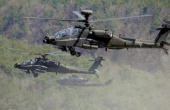 US Apache helicopters take to the air during a joint gunnery exercise at a military firing range in Pocheon near the heavilyfortified border with...