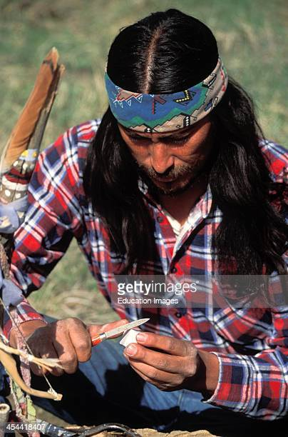 Apache Man Carving Bear Statue From Alabaster