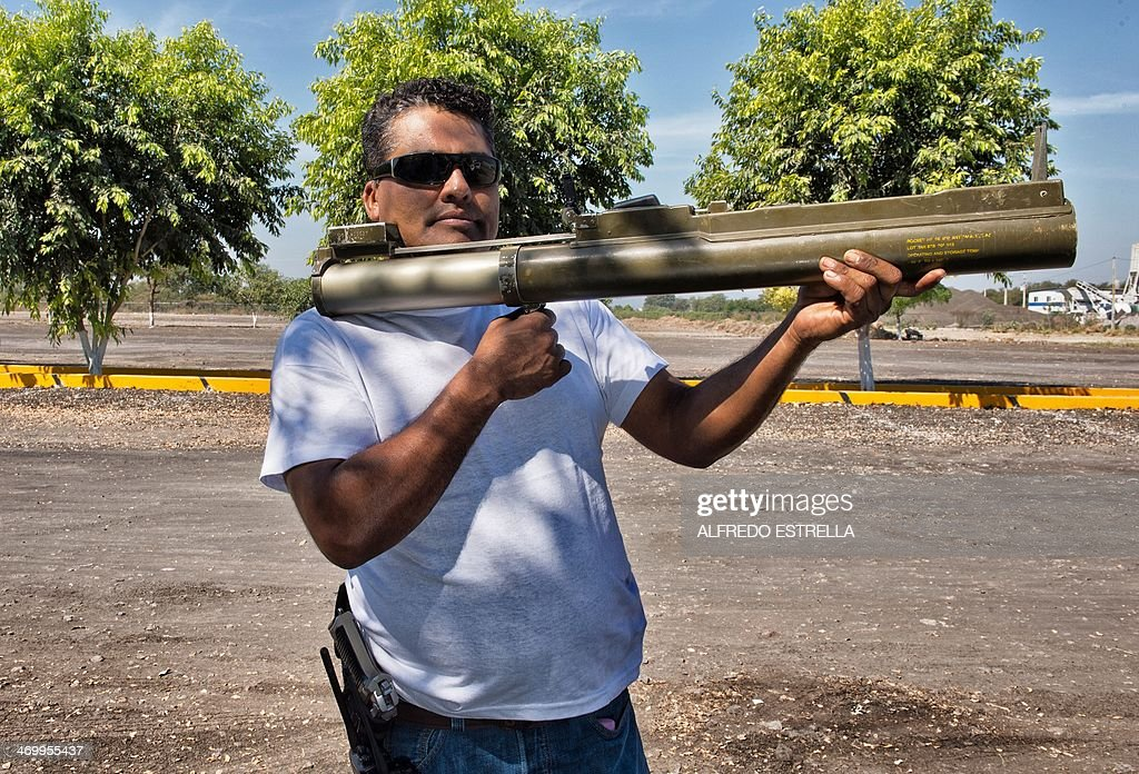 'Aparato' a member of the socalled selfdefense groups poses for a photo with a LAW rocket launcher in Apatzingan Michoacan state Mexico on February...