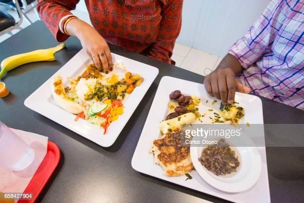 TORONTO ON SEPTEMBER 13 Aparita Bhandari walks us through how to eat Somali food with Bashir Munye at Istar Restaurant in Toronto
