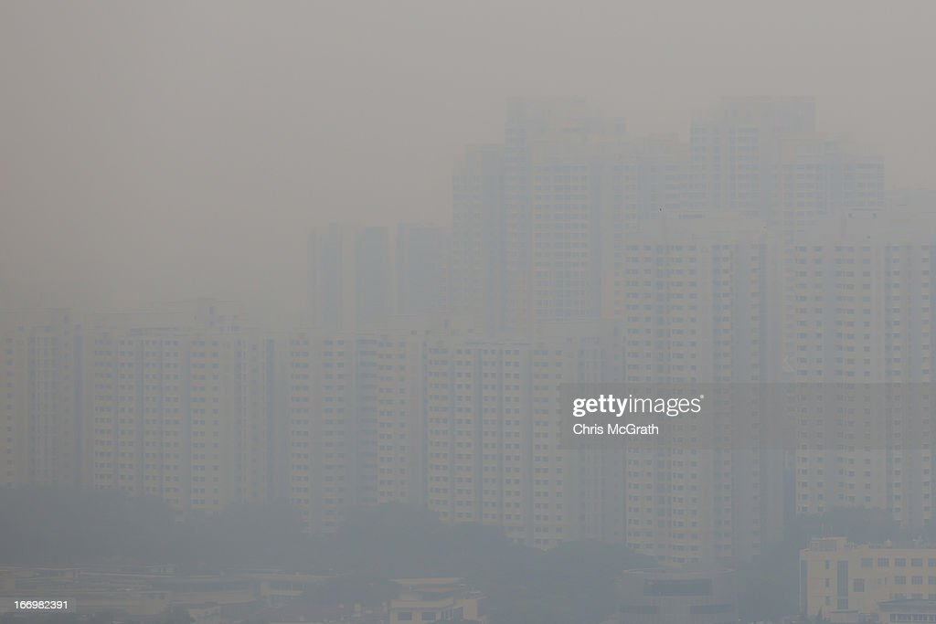 Apartment blocks are seen covered in smoke haze on April 19, 2013 in Chinatown, Singapore. The haze was created by burning off in neighbouring Sumatra and caused the Pollutant Standards Index to rise, hovering between 28 and 43.
