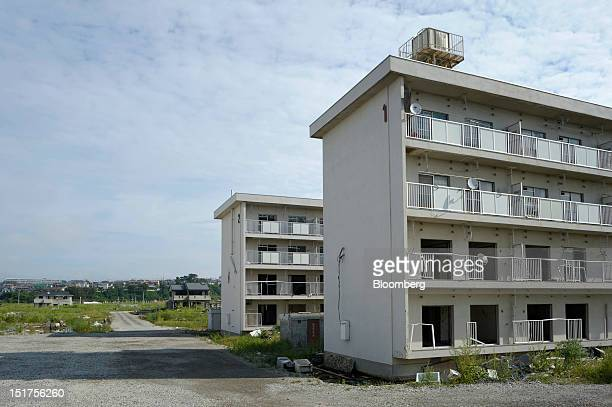 Apartment blocks stand in an area damaged by last year's March 11 earthquake and tsunami in Ishinomaki City Miyagi Prefecture Japan on Wednesday Sept...