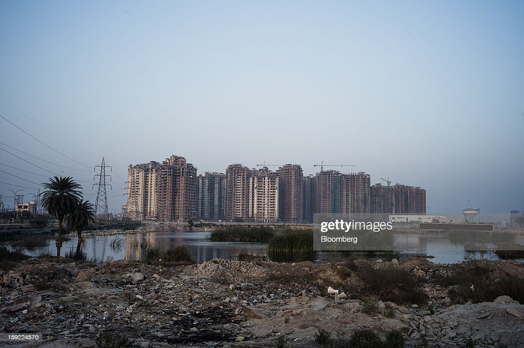Apartment blocks stand under construction in Noida, Uttar Pradesh, India, on Wednesday, Jan. 9, 2013. India's Finance Ministry predicts GDP growth of as little as 5.7 percent in the year to March 31, the least in a decade. Photographer: Sanjit Das/Bloomberg via Getty Images