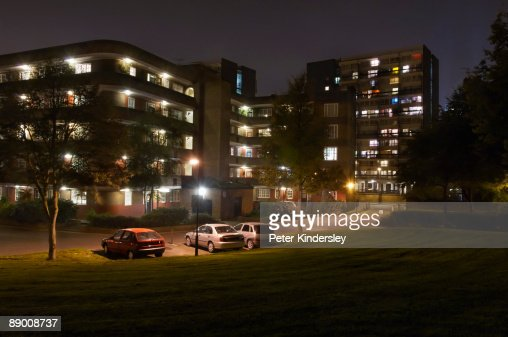 Apartment Building And Street At Night Stock Photo Getty Images
