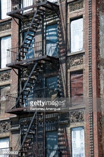 Apartment Building With Fire Escape Ladders New York City Stock