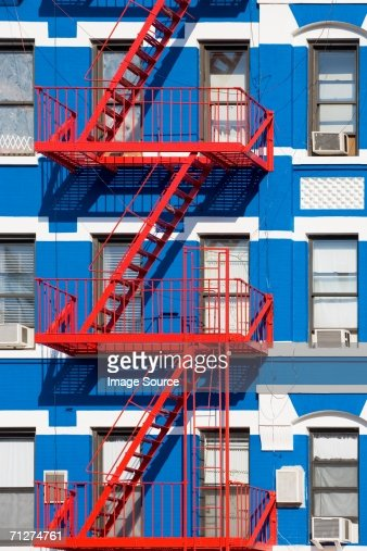 apartment building with fire escapes stock photo getty