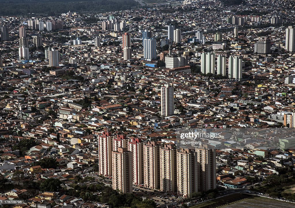 Apartment buildings stand in the foreground of this aerial photo taken in Sao Paulo, Brazil, on Friday, Aug. 23, 2013. Home sales in Sao Paulo, Brazils biggest real-estate market, rose 46 percent in January through June from a year earlier, while housing starts climbed 51 percent, according to Embraesp, a property research group, and Secovi, a real-estate agency association. Photographer: Paulo Fridman/Bloomberg via Getty Images