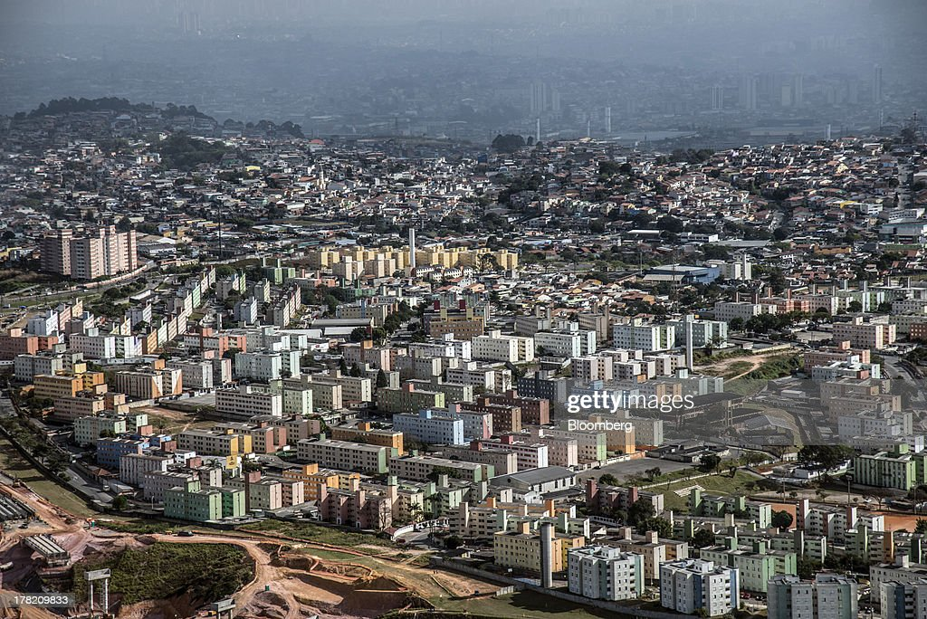 Apartment buildings stand in this aerial photo of eastern Sao Paulo, Brazil, on Friday, Aug. 23, 2013. Home sales in Sao Paulo, Brazils biggest real-estate market, rose 46 percent in January through June from a year earlier, while housing starts climbed 51 percent, according to Embraesp, a property research group, and Secovi, a real-estate agency association. Photographer: Paulo Fridman/Bloomberg via Getty Images