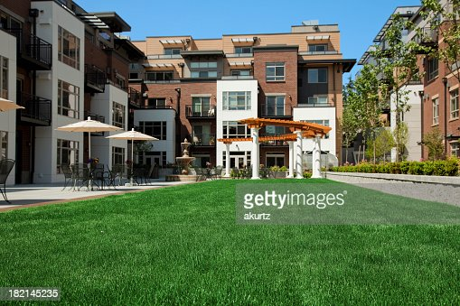 Apartment Building Courtyard apartment condos home courtyard landscaped grass building tables
