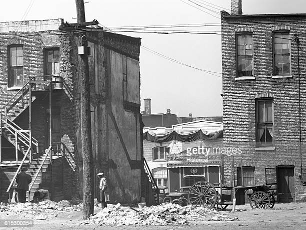 Apartment houses and a funeral parlor in a slum of Chicago Illinois April 1941