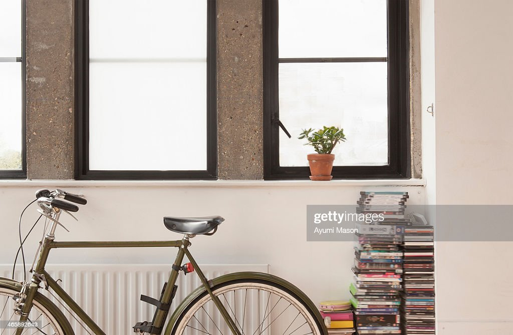 Apartment interior with bicycle and cd collection : Stock Photo