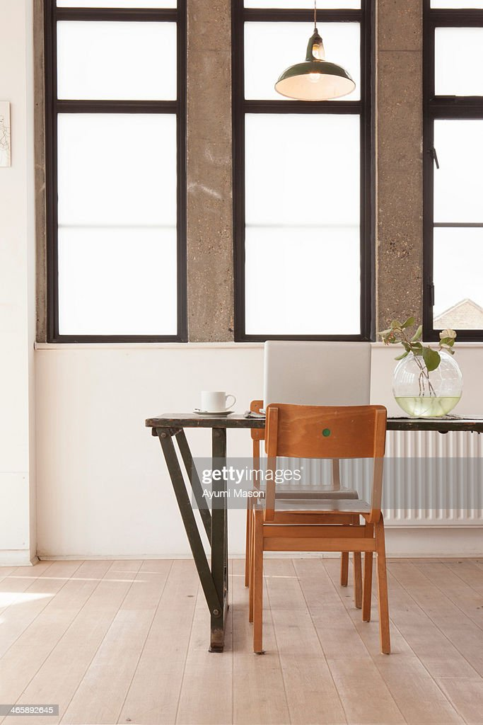 Apartment interior with table and chairs