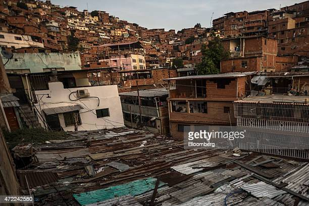 Apartments stand on a hillside in the Petare neighborhood home to many Colombian immigrants on the outskirts of Caracas Venezuela on Tuesday April 28...