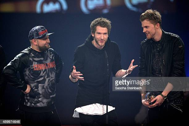 'ApeCrime' celebrate winning the 1Live Krone award during the 1Live Krone 2014 at Jahrhunderthalle on December 4 2014 in Bochum Germany