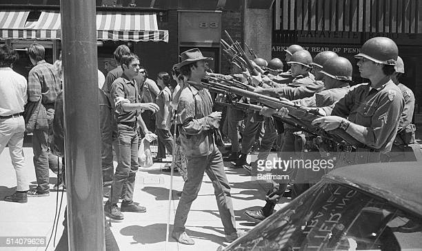 A'People's Park' demonstrator stands his ground as a line of National Guard officers with bayonets advances on him on May 19 1969 After they were...