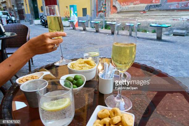 Aperitif with two Glasses of Prosecco Olives and Nuts in the City Centre on June 29 2015 in Naples Italy