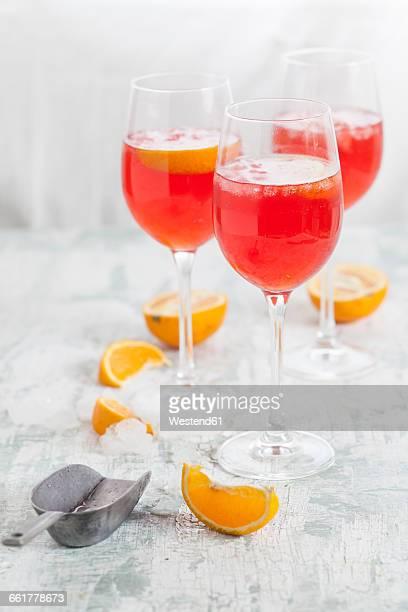 Aperol spritz, bitter liqueur, prosecco wine, sparkling mineral water and orange slice