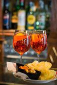 aperol spritz in the wine glasses on a dark background
