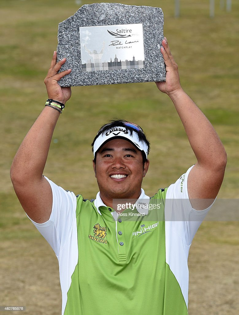 Aphibarnrat of Thailand with the winners trophy after his match against Robert Karlsson of Sweden in the final of the Saltire Energy Paul Lawrie Matchplay at Murcar Links Golf Course on August 2, 2015 in Aberdeen, Scotland.