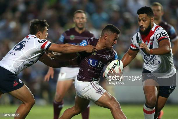 Api Koroisau of the Sea Eagles is tackled by the Roosters defence during the NRL Trial match between the Manly Warringah Sea Eagles and Sydney...