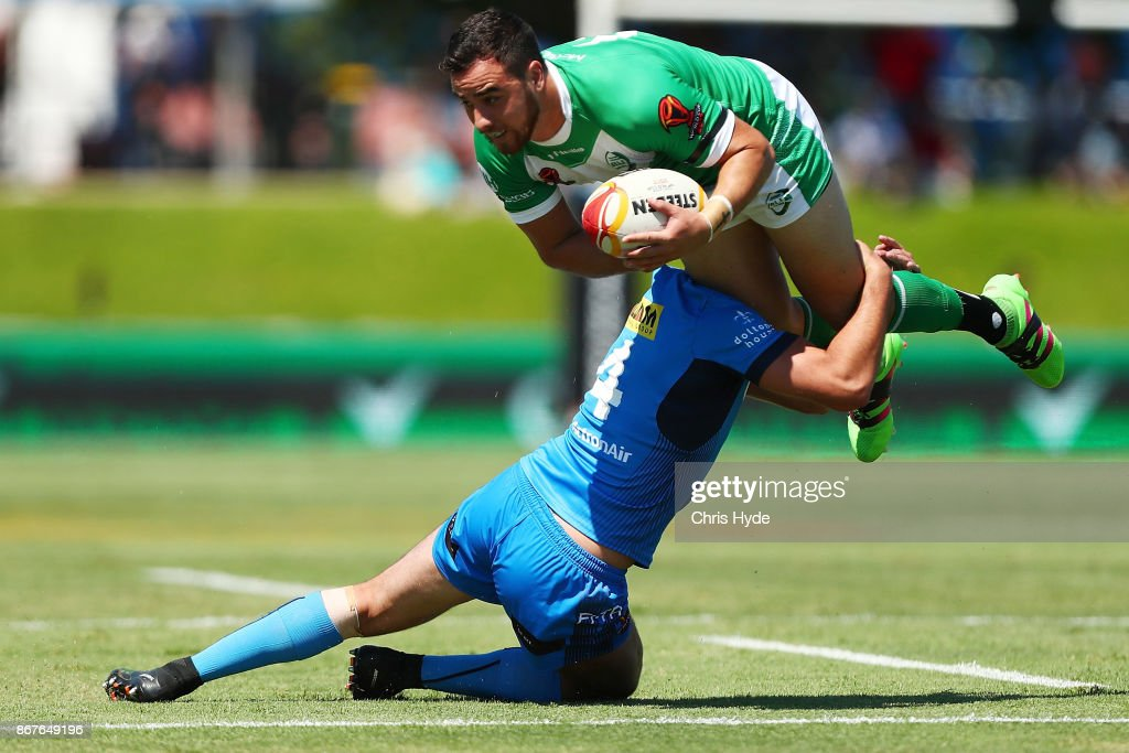 Api Pewhairangi of Ireland is tackled by Nathan Milone of Italy during the 2017 Rugby League World Cup match between Ireland and Italy at Barlow Park on October 29, 2017 in Cairns, Australia.
