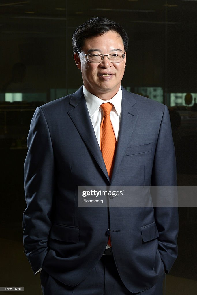 Apichart Chutrakul, chief executive officer of Sansiri Pcl, poses for a portrait in Singapore, on Tuesday, July 16, 2013. Sansiri sees demand from real estate buyers in Singapore and Hong Kong because Thai properties are still inexpensive, Apichart said. Photographer: Munshi Ahmed/Bloomberg via Getty Images
