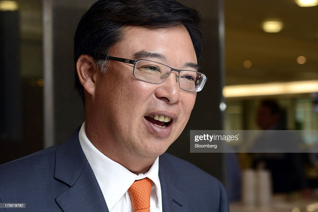 Apichart Chutrakul, chief executive officer of Sansiri Pcl, speaks during an interview in Singapore, on Tuesday, July 16, 2013. Sansiri sees demand from real estate buyers in Singapore and Hong Kong because Thai properties are still inexpensive, Apichart said. Photographer: Munshi Ahmed/Bloomberg via Getty Images
