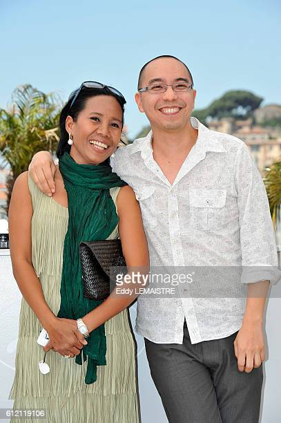 Apichatppong Weerasethakul and Wallapa Mongkolprasert at the photo call for Uncle Boonmee Who Can Recall His Past Lives during the 63rd Cannes...