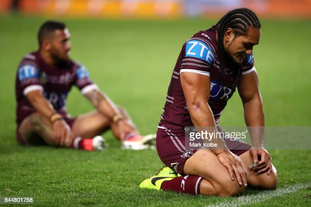 Apisai Koroisau and Martin Taupau of the Sea Eagles look dejected after defeat during the NRL Elimination Final match between the Manly Sea Eagles...