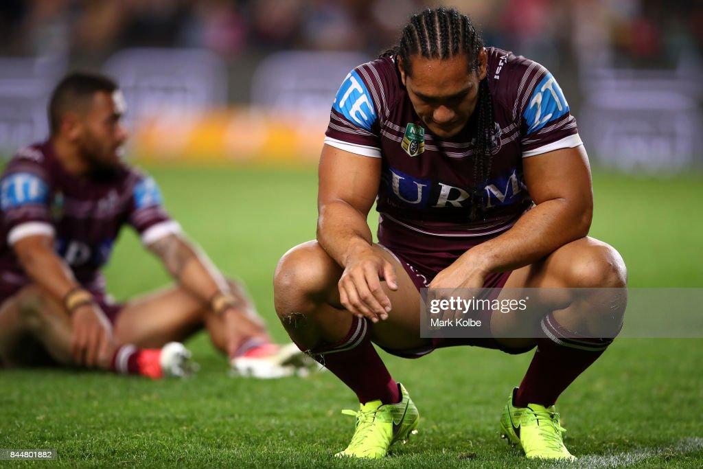 Apisai Koroisau and Martin Taupau of the Sea Eagles look dejected after defeat during the NRL Elimination Final match between the Manly Sea Eagles and the Penrith Panthers at Allianz Stadium on September 9, 2017 in Sydney, Australia.