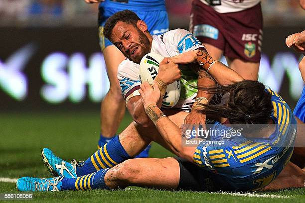 Apisai Koroisau of Manly drives over the try line to score during the round 22 NRL match between the Parramatta Eels and the Manly Sea Eagles at...