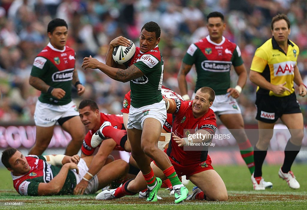 Apisai Koroisau of Souths makes a break away from the defence of Trent Merrin during the NRL Charity Shield match between the South Sydney Rabbitohs and the St George Dragons at WIN Stadium on February 22, 2014 in Wollongong, Australia.