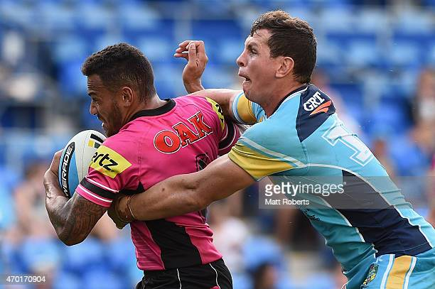 Apisai Koroisau of the Panthers is tackled by Greg Bird of the Titans during the round seven NRL match between the Gold Coast Titans and the Penrith...