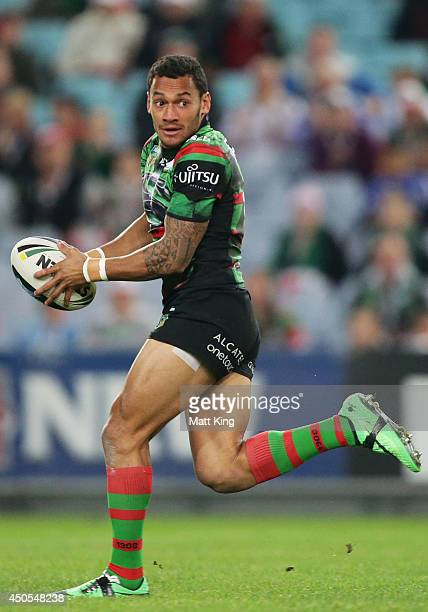 Apisai Koroisau of the Rabbitohs makes a break during the round 14 NRL match between the South Sydney Rabbitohs and the Wests Tigers at ANZ Stadium...