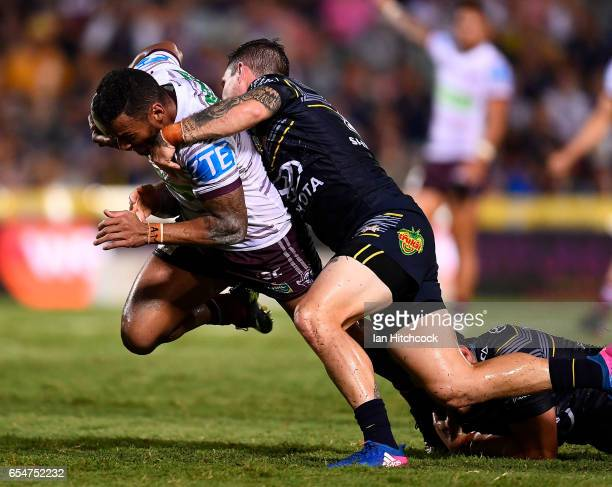 Apisai Koroisau of the Sea Eagles is tackled by Benjamin Hampton of the Cowboys during the round three NRL match between the North Queensland Cowboys...