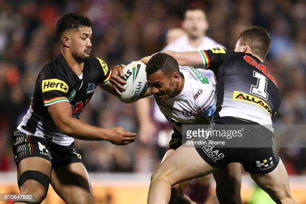 Apisai Koroisau of the Sea Eagles is tackled by the Panthers defence during the round 18 NRL match between the Penrith Panthers and the Manly Sea...