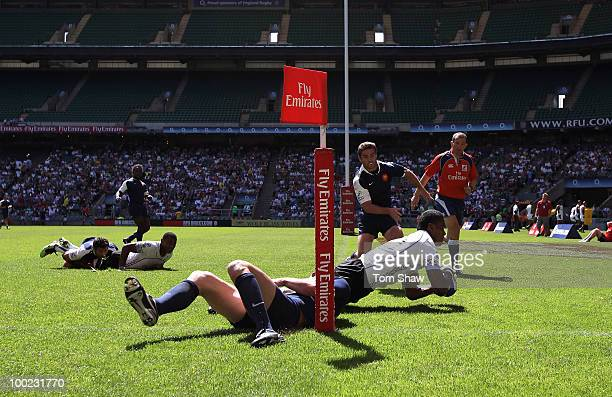 Apisai Naiyabo of Fiji scores a try during the Pool C match between Fiji and France during day one of the IRB London Sevens at Twickenham Stadium on...