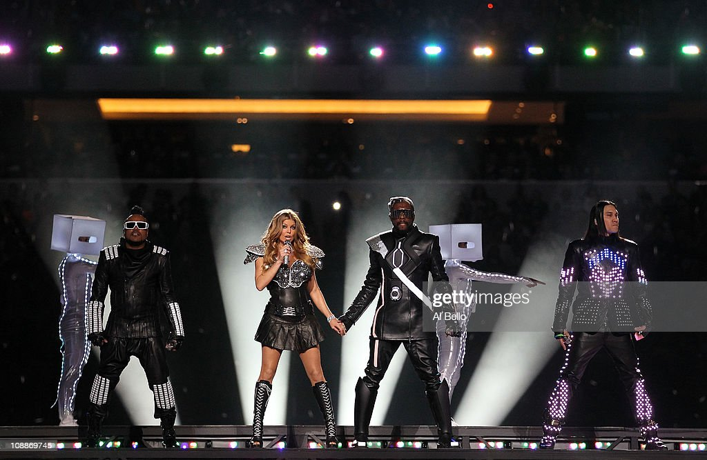 apl.de.ap, Fergie, will.i.am and Taboo of the Black Eyed Peas perform during the Bridgestone Super Bowl XLV Halftime Show at Cowboys Stadium on February 6, 2011 in Arlington, Texas.