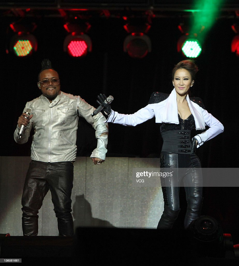 Apl.de.ap of Black Eyed Peas and Coco Lee perform on stage during Booey Lehoo Beijing Concert at National Indoor Stadium on December 17, 2011 in Beijing, China.