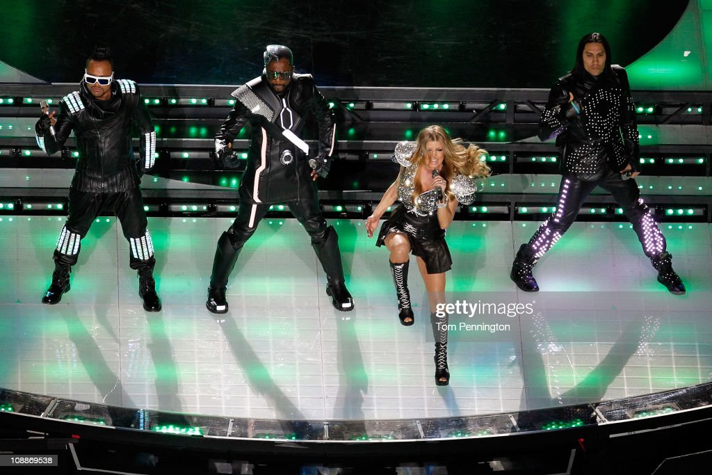 apl.de.ap, will.i.am, Fergie and <a gi-track='captionPersonalityLinkClicked' href=/galleries/search?phrase=Taboo+-+S%C3%A5ngare&family=editorial&specificpeople=203068 ng-click='$event.stopPropagation()'>Taboo</a> of the Black Eyed Peas perform during the Bridgestone Super Bowl XLV Halftime Show at Cowboys Stadium on February 6, 2011 in Arlington, Texas.