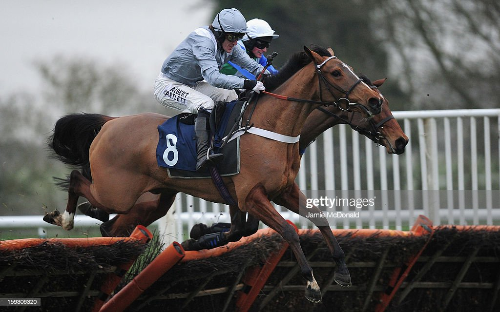 McCoy rides Glorious Twelfth over the last to win the Connoll's Red Mills Horse Cooked Mix Mares Maiden Hurdle Race at Huntingdon Racecourse on January 11, 2013 in Huntingdon, England.