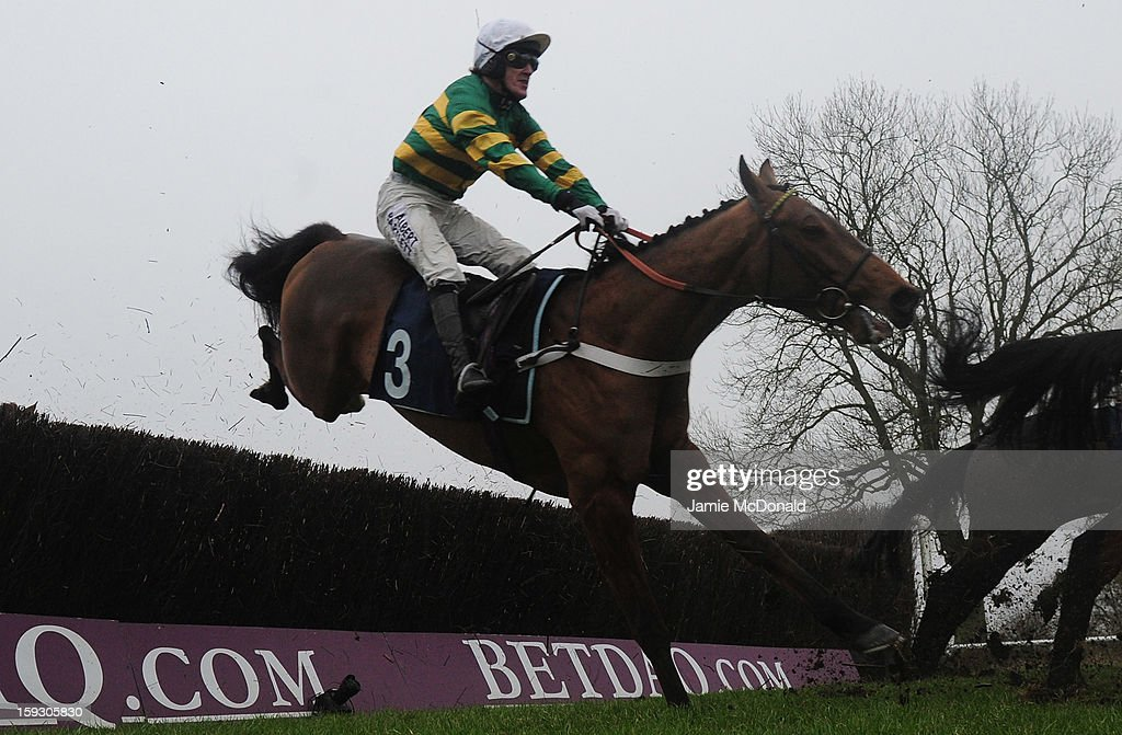 McCoy rides Malt Master over the ditch to win the Connoll's Red Mills Horescare Cubes Novices Steeple Chase at Huntingdon Racecourse on January 11, 2013 in Huntingdon, England.