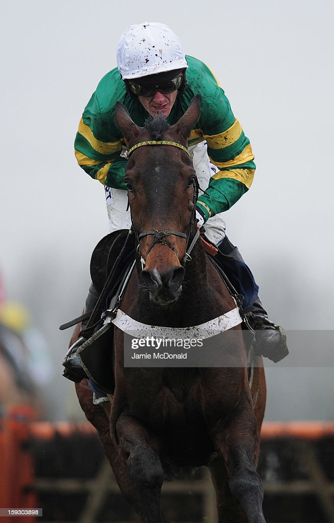 McCoy rides My Tent or Yours over the last to win the Connoll's Red Mills National Hunt Novices Hurdle Race at Huntingdon Racecourse on January 11, 2013 in Huntingdon, England.