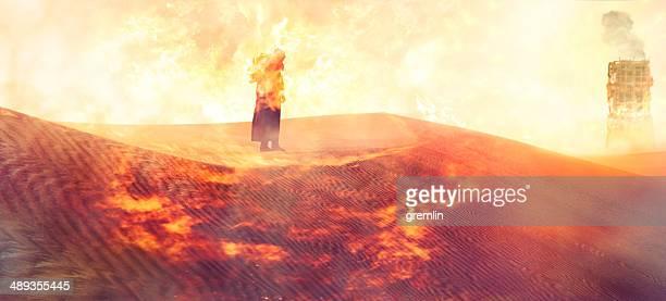 Apocalypse lone survivor walking over burning landscape