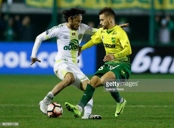 Apodi of Chapecoense fights for the ball with Agustin Bouzat of Defensa y Justicia during a first leg match between Defensa y Justicia and...