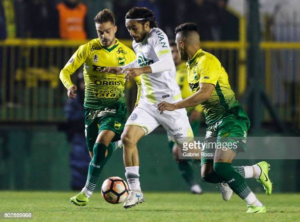 Apodi of Chapecoense fights for the ball with Leonel Miranda of Defensa y Justicia during a first leg match between Defensa y Justicia and...