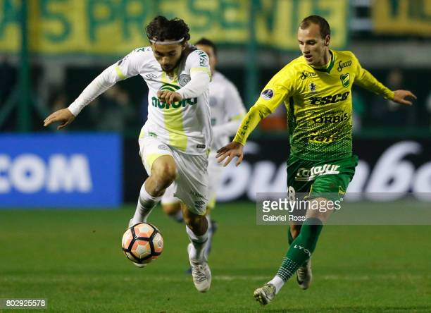 Apodi of Chapecoense fights for the ball with Tomas Pochettino of Defensa y Justicia during a first leg match between Defensa y Justicia and...