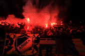 Apoel fans celebrate after their team won the UEFA Champions League football match against Olympique Lyonnais at the GSP Stadium in the Cypriot...