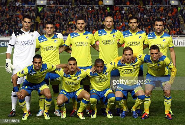 Apoel FC players pose for a group picture before the start of their UEFA Champions League group G football match against FC Shakhtar in the Cypriot...